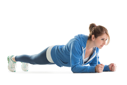 Woman in blue performing the plank strengthening exercise