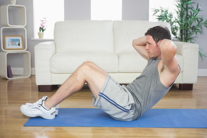 Man doing the sit up exercise to strengthen his lower back - BAD for lower back pain!