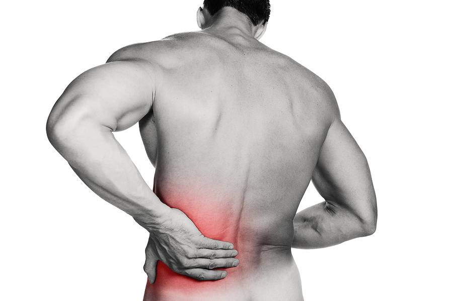 man with low back trigger point pain