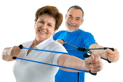 man and woman strengthening the shoulder muscle