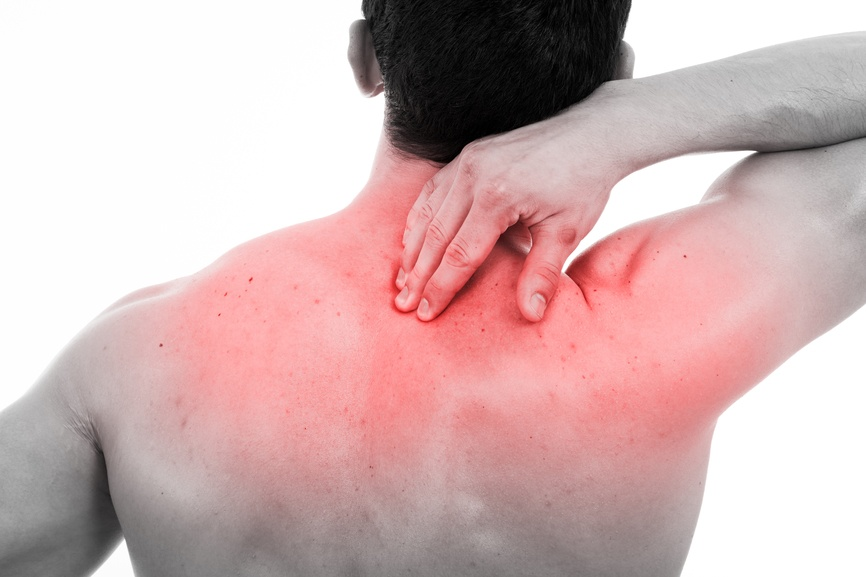 man massaging upper shoulder muscle pain